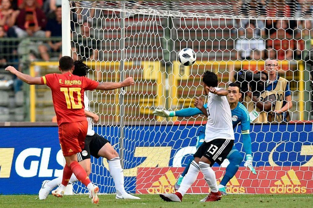 GOL CANTIK: Penyerang Belgium, Eden Hazard (jersi merah) menjaringkan gol pasukannya semasa kemenangan 3-0 ke atas Mesir dalam satu perlawanan persiapan menjelang Piala Dunia. - Foto AFP