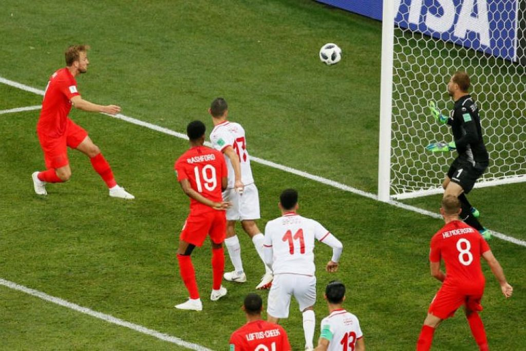 GOL KEDUA: Pemain England, Harry Kane, menjaringkan gol kedua pasukannya dalam perlawanan antara Tunisia dengan England di Volgograd Arena di Volgograd, Russia.