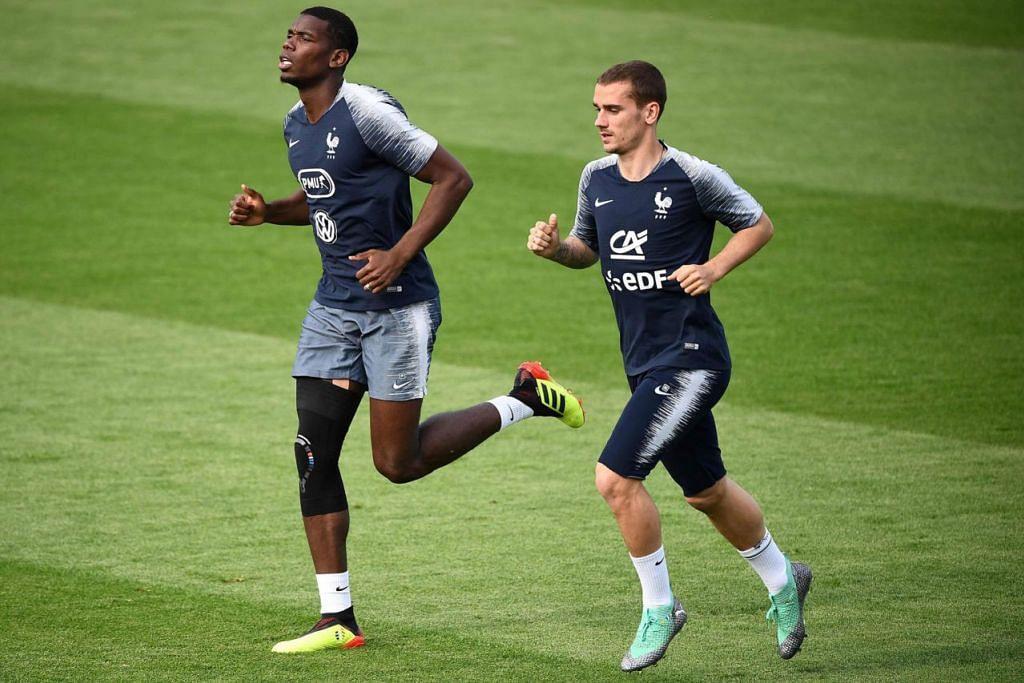 INGIN TETAP MENANG: Perancis yang diwakili pemain handalan seperti Paul Pogba (kiri) dan Antoine Griezmann akan berikan yang terbaik semasa menentang Denmark. - Foto AFP
