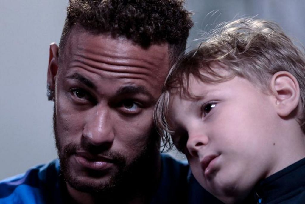 Neymar bersama anaknya Davi Lucca semasa interviu bersama AFP pada Sabtu, 21 Julai.
