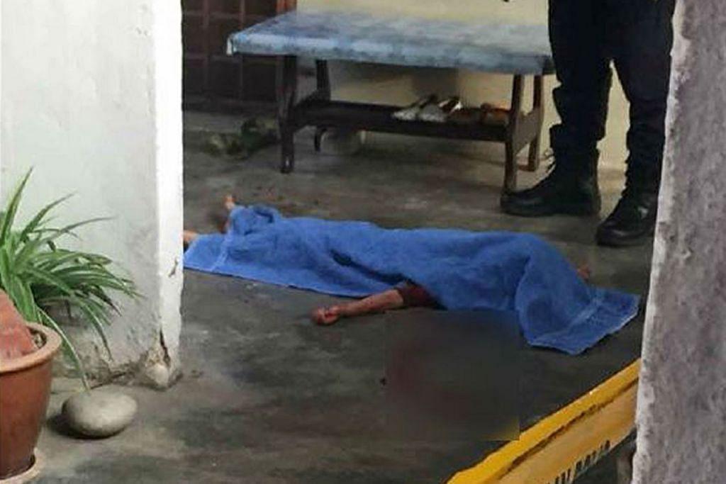 MANGSA KEGANASAN: Mayat budak berusia lima tahun ditutup kanvas selepas menjadi mangsa bapanya yang mempunyai rekod jenayah berkaitan dadah. - Foto NSTP