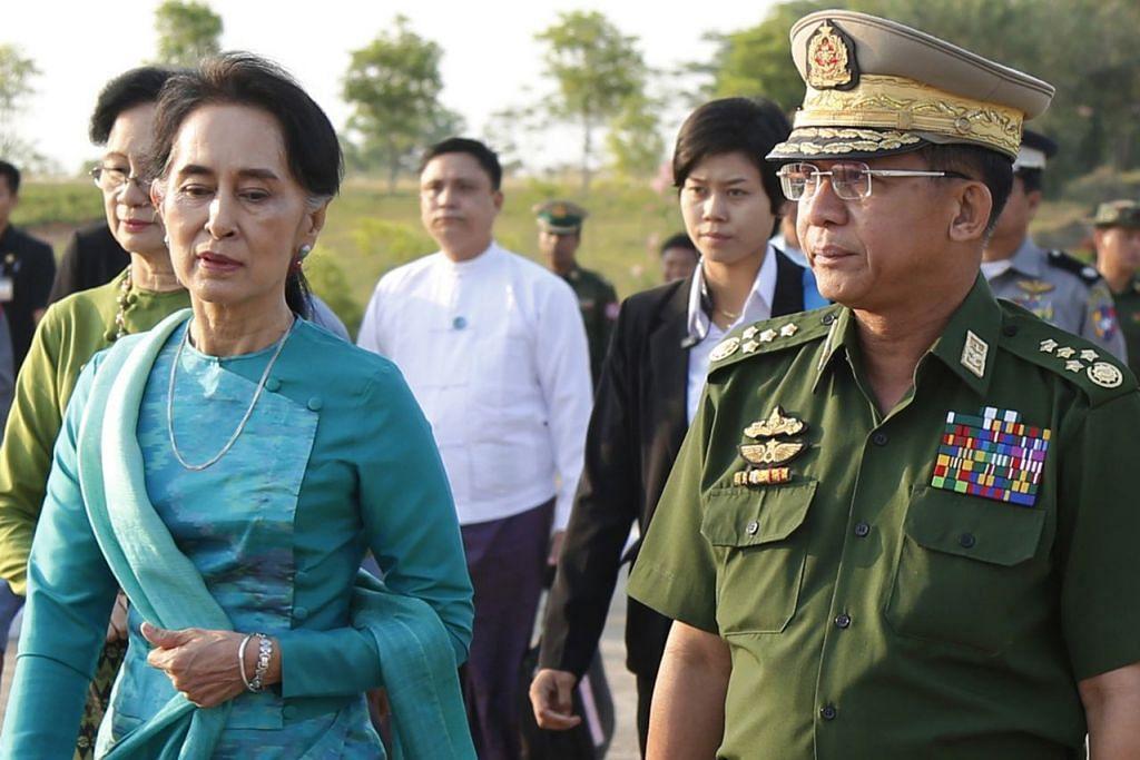 DIBIDAS PBB: Cik Aung San Suu Kyi (kiri) dan Ketua Jeneral Min Aung Hlaing kedua-duanya menghadapi kecaman daripada pihak penyiasat PBB atas peranan masing-masing dalam pembunuhan beramai-ramai minoriti Rohingya. - Foto fail EPA