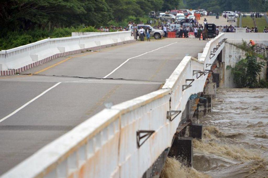 Jambatan lebuh raya Yangon-Mandalay kelihatan rosak disebabkan air yang deras akibat empangan yang pecah. FOTO: AFP