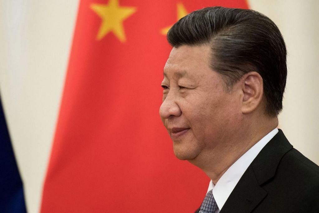 MAHU PERMUDAH DAGANGAN SEJAGAT: Encik Xi berkata China akan terus membuka ekonominya dengan menyediakan persekitaran adil dan telus bagi perniagaan asing. - Foto REUTERS