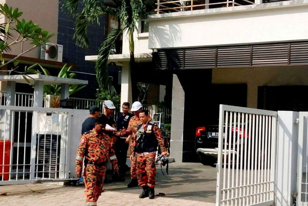 """KESAN PETROL: Menurut mesej yang tular di media sosial, Allahyarham Nazrin mengambil ubat bagi migrain dan mengecas telefon bimbitnya sebelum tidur. Telefon itu """"terlalu panas dan meletup"""" mengakibatkan kebakaran pada katil dan kematian beliau. Namun, siasatan forensik (atas) oleh Jabatan Bomba dan Penyelamat Malaysia """"menunjukkan ada kesan petrol di lokasi kejadian"""". - Foto NSTP"""