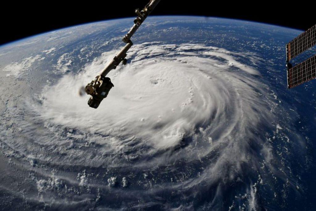 JADI ANCAMAN: Ribut 'Florence' yang dilihat dari Stesen Angkasa Antarabangsa sedang ribut itu bergerak dari Lautan Atlantik ke kawasan pantai timur Amerika. - Foto REUTERS