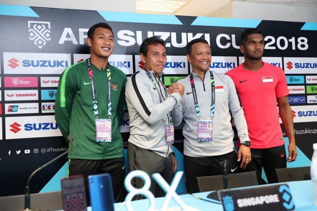 (Dari kiri) Kapten Indonesia Hansamu Yama dan jurulatih Bima Sakti bersama jurulatih Singapura Fandi Ahmad dan kapten Hariss Harun di sidang media Piala AFF Suzuki hari ini.