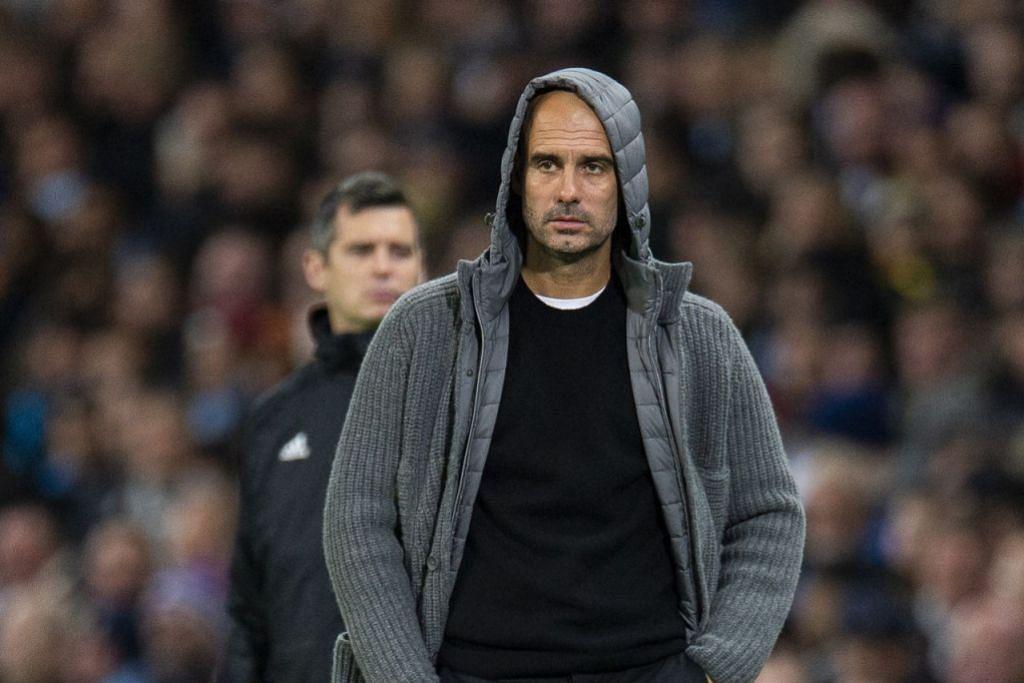 PENYATU PASUKAN: Pep Guardiola berjaya mengembleng tenaga pemain bertaraf dunia untuk berjuang secara konsisten bagi Manchester City. - Foto EPA