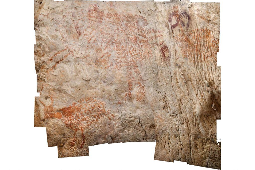 SENI SILAM: Foto daripada Nature Publishing Group menunjukkan karya seni figuratif tertua di dunia dari Borneo, bertarikh sekurang-kurangnya 40,000 tahun. Gua-gua batu kapur di Kalimantan Timur di Borneo mengandungi ribuan imej seni batu. - Foto AFP