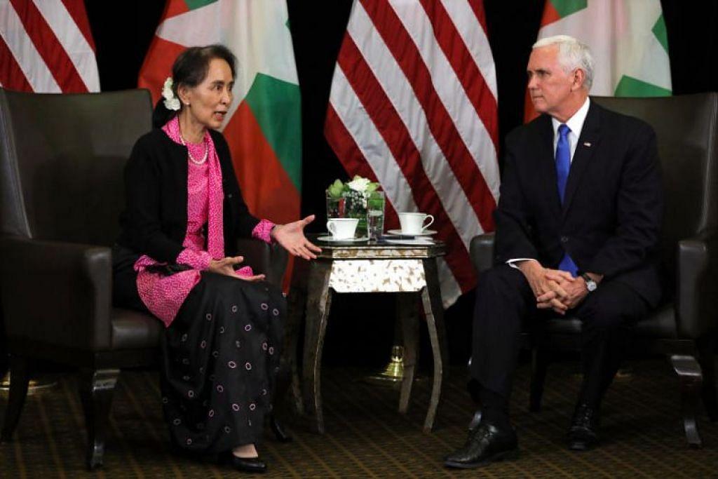 Naib Presiden Mike Pence (kanan) memberitahu pemimpin Myanmar Aung San Suu Kyi di luar Sidang Kemuncak Asean di Singapura bahawa penganiayaan yang berlaku terhadap masyarakat Rohingya tidak dapat dimaafkan. FOTO: REUTERS