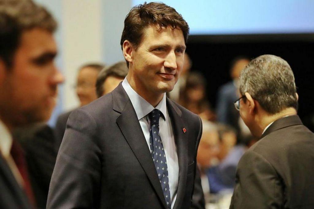 Perdana Menteri Canada Justin Trudeau berkata negaranya akan bekerjasama dengan China bagi perjanjian perdagangan bebas. FOTO: GAVIN FOO