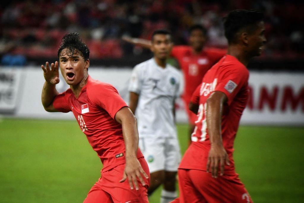 Ikhsan Fandi meraikan gol kedua yang dijaringkannya, satu tendangan akrobatik yang memperdaya penjaga gawang Timor-Leste