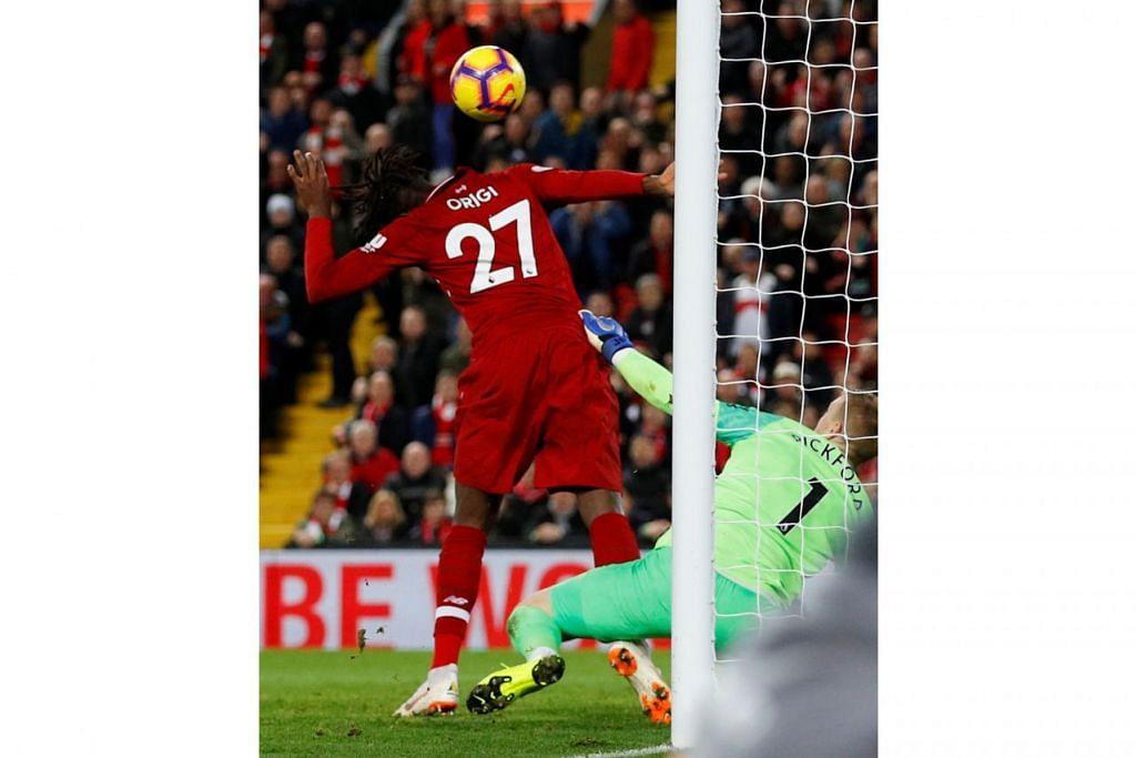 JARINGAN MINIT TERAKHIR: Divock Origi yang bermain buat kali pertama musim ini memastikan kemenangan berpihak kepada Liverpool dengan menjaringkan gol tunggal pasukannya ke atas Everton. - Foto REUTERS