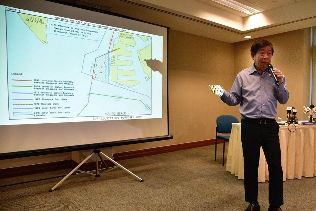 BERI PENJELASAN: Encik Khaw menunjukkan 14 pencerobohan (titik hitam) oleh kapal kerajaan Malaysia dari 24 November hingga 5 Disember dalam sidang akhbar semalam. - Foto BH oleh DESMOND WEE