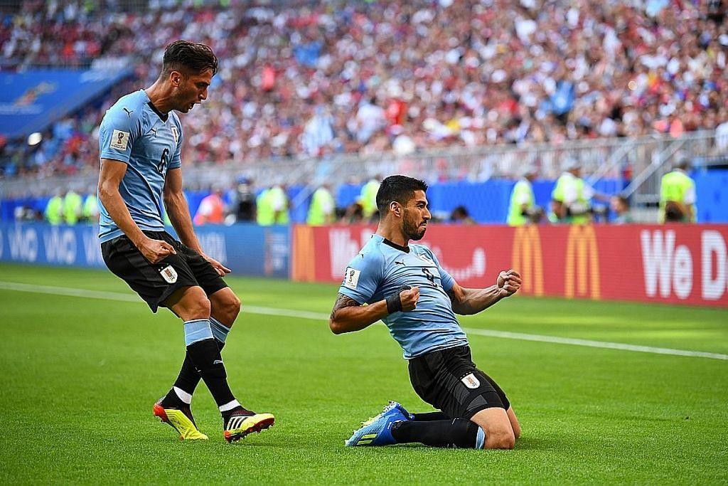 Uruguay benam Russia, muncul juara kumpulan