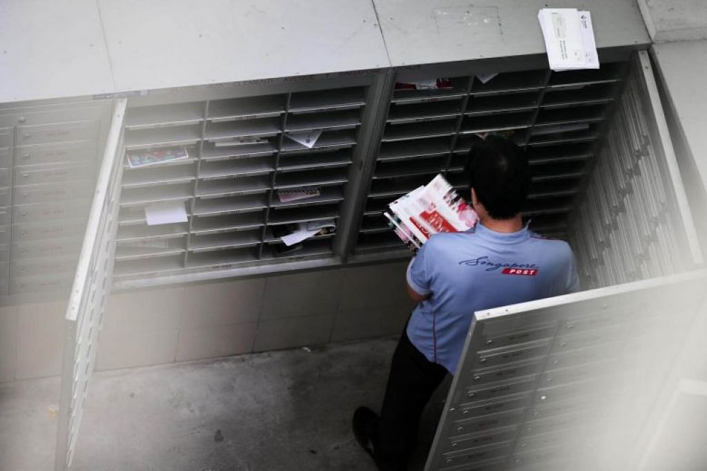 SingPost apologises for service failures during year-end peak season, even as postmen pull extra hours