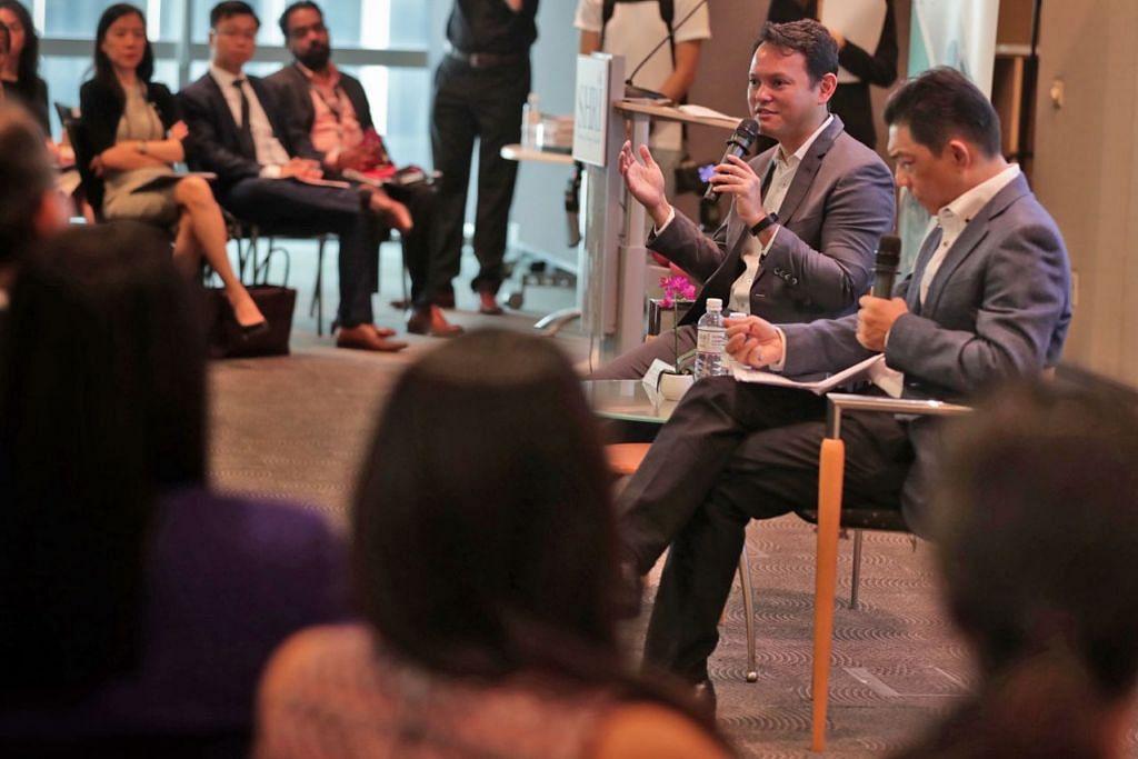 MEMENUHI KEPERLUAN PEKERJA: Encik Zaqy (dua dari kanan) dengan Encik Erman Tan, Presiden SHRI, di sesi dialog bersama kakitangan HR semalam. - Foto BH oleh KELVIN CHNG
