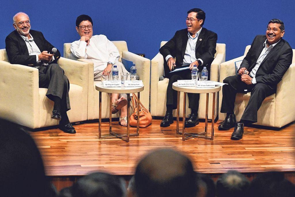 SIMPOSIUM ST GALLEN: (Dari kiri) CEO DBS Group, Encik Piyush Gupta; Presiden NCSS, Cik Anita Fam; CEO Singapore Pools, Encik Seah Chin Siong, menyertai perbincangan panel di Simposium St Gallen Forum Singapura Sabtu lalu.   - Foto BH oleh CHONG JUN LIANG