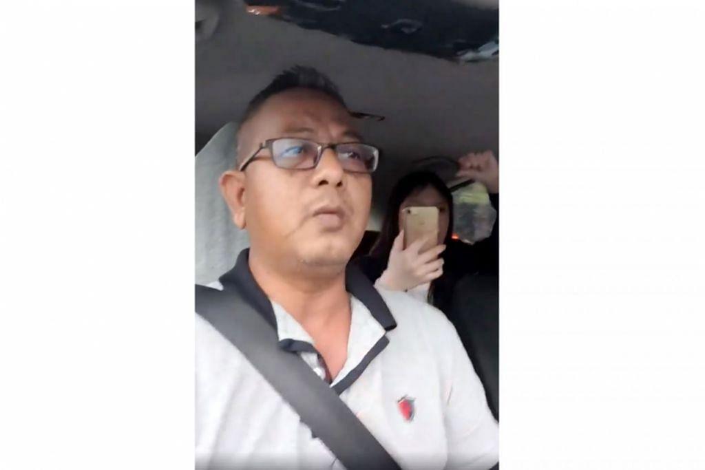 RAKAMAN VIDEO: Gambar ini merupakan tangkap layar rakaman video yang dibuat pemandu Gojek, Encik Kamaruzzaman Abdul Latiff, menggunakan telefon bimbitnya semasa kejadian pertengkaran dengan seorang penumpang dalam keretanya pada 29 Januari lalu. – Foto FACEBOOK