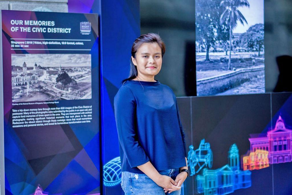 GAMBAR MENJADI SEBAHAGIAN SEJARAH: Gambar keluarga yang disumbangkan Cik Darna Arifin menjadi sebahagian daripada lebih 600 imej yang lain dalam satu video selama 32 minit 34 saat yang menampilkan Daerah Sivik pada masa lalu. Ia dimainkan di Padang Atrium di Galeri Nasional Singapura sempena Festival 'Light to Night' 2019 Edisi Bicentennial - 'Our Memories of the Civic District' (Memori Kita di Daerah Sivik). - Foto BH oleh NUR DIYANA TAHA