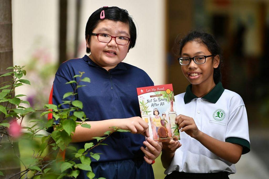 BERSAHABAT: Hoon Shu Yen (kiri) dari Sekolah Minds Fernvale Gardens School dan Nur Marsha Danisha Sufian dari Sekolah Rendah Fernvale kini bersahabat. - Foto BH oleh LIM YAOHUI