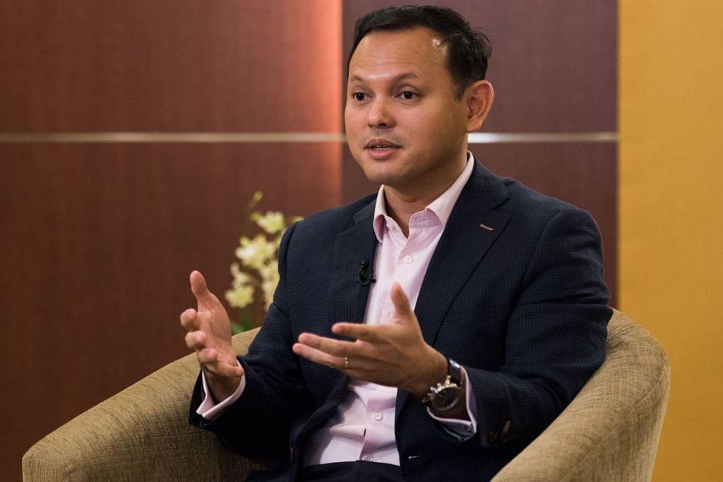 ENCIK ZAQY MOHAMAD: Menjelaskan bahawa pendirian Singapura adalah mewujudkan pertumbuhan tenaga kerja yang berdaya tahan dan tidak membiarkan kadar gaji rendah, dan ingin warga menjadi tulang belakang tenaga kerja. - Foto fail