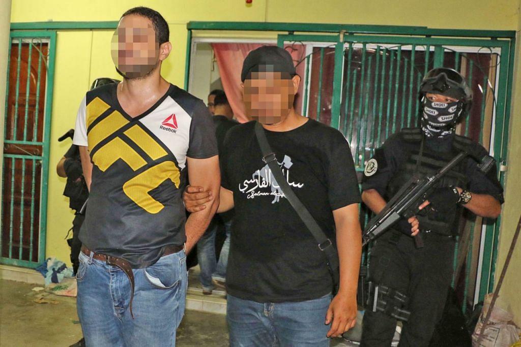 RANCANG GANAS: Enam warga Mesir dan seorang warga Tunisia merupakan antara sembilan orang disyaki terlibat dalam kumpulan pengganas yang ditangkap antara 2 dengan 9 Feb lalu dalam operasi Bahagian Antipengganas, Cawangan Khas, Polis Diraja  Malaysia (PDRM) di sekitar Lembah Klang dan Sarawak. - Foto PDRM