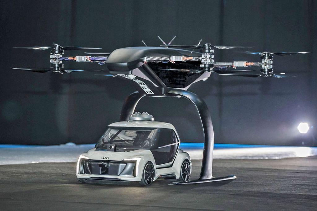 """Contoh kereta terbang di negara lain: PAMERKAN KONSEP: Di acara Drone Week di Amsterdam baru-baru ini, Audi, Airbus dan Italdesign mempersembahkan buat pertama kalinya prototaip pandu dan terbang """"Pop.Up Next"""". Konsep inovatif bagi teksi terbang ini menggabungkan kereta elektrik pandu sendiri dengan sebuah dron penumpang. Dalam penerbangan ujian awam yang pertama, modul udara dengan tepat meletakkan kapsul penumpang pada modul darat, yang kemudiannya memandu dari tapak ujian secara autonomi. Ini masih merupakan model skala 1: 4. - Foto AUDI"""