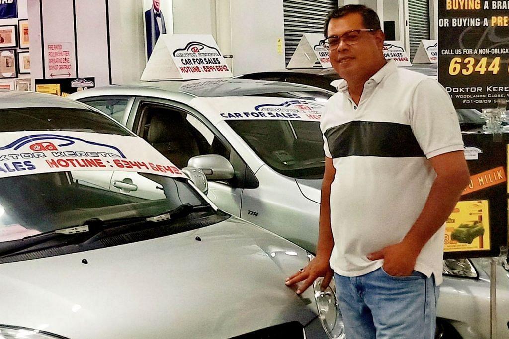 PERTIMBANGKAN KEMAMPUAN: Encik Ismail Yusof menasihatkan pelanggan membuat pertimbangan sebelum membeli kereta. - Foto fail