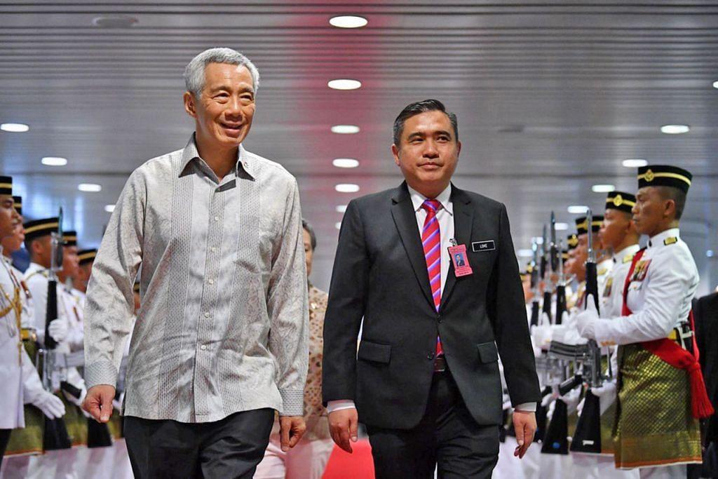 PM Lee tiba di Putrajaya, hadiri Rahat pemimpin M'sia-S'pura - Foto BH oleh LIM YAOHUI