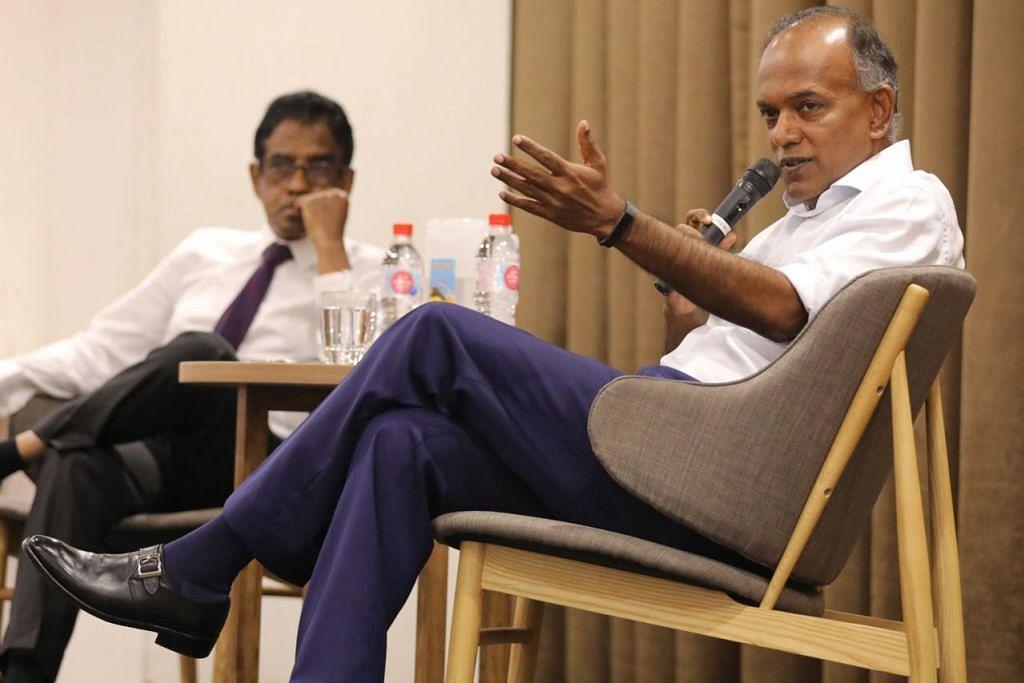 ATASI KEPRIHATINAN: Encik Shanmugam (kanan) mengulas keprihatinan tentang rang undang-undang untuk menangani berita palsu dalam dialog anjuran Persatuan Peguam Muslim (AML) dan Wise SG semalam. Dialog itu dipengerusikan Presiden AML, Encik Noor Mohamed Marican (kiri). - Foto BH oleh ONG WEE JIN