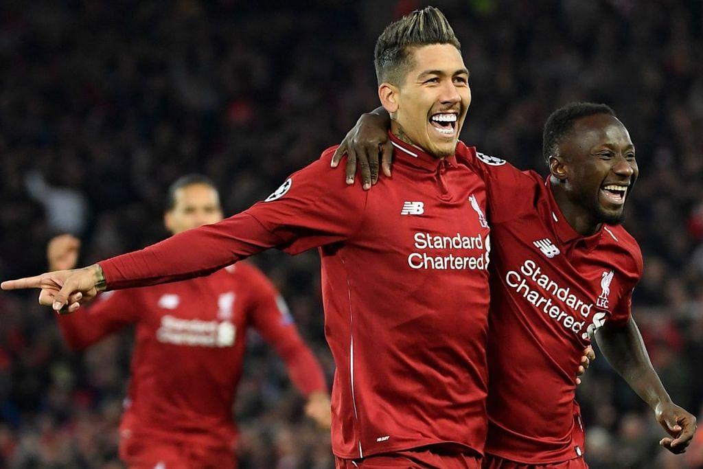 PUAS: Penyerang Liverpool, Roberto Firminho, dan pemain tengah kelab itu, Naby Keita (kanan), meraikan kemenangan mereka di depan penyokong kelab selepas Firmonho berjaya menjaringkan gol kedua Liverpool pada minit ke-26 semasa berdepan dengan kelab Porto bagi pusingan pertama suku akhir Liga Juara-Juara Eropah semalam. - Foto AFP