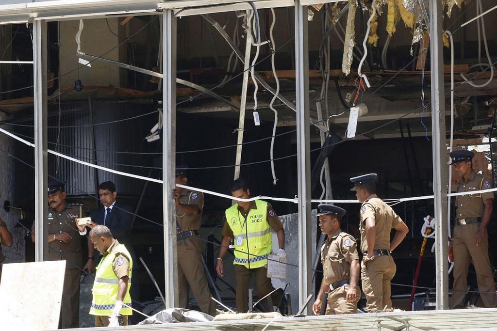 TINJAU KEROSAKAN: Pegawai polis melakukan siasatan di hotel mewah Shangri-La yang juga menjadi sasaran serangan. - Foto EPA-EFE