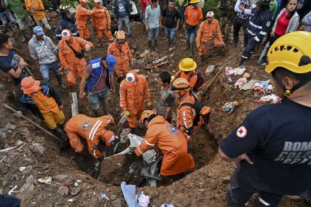 Pekerja penyelamat mencari mangsa di Rosas, Valle del Cauca, di barat daya Colombia. FOTO: AFP