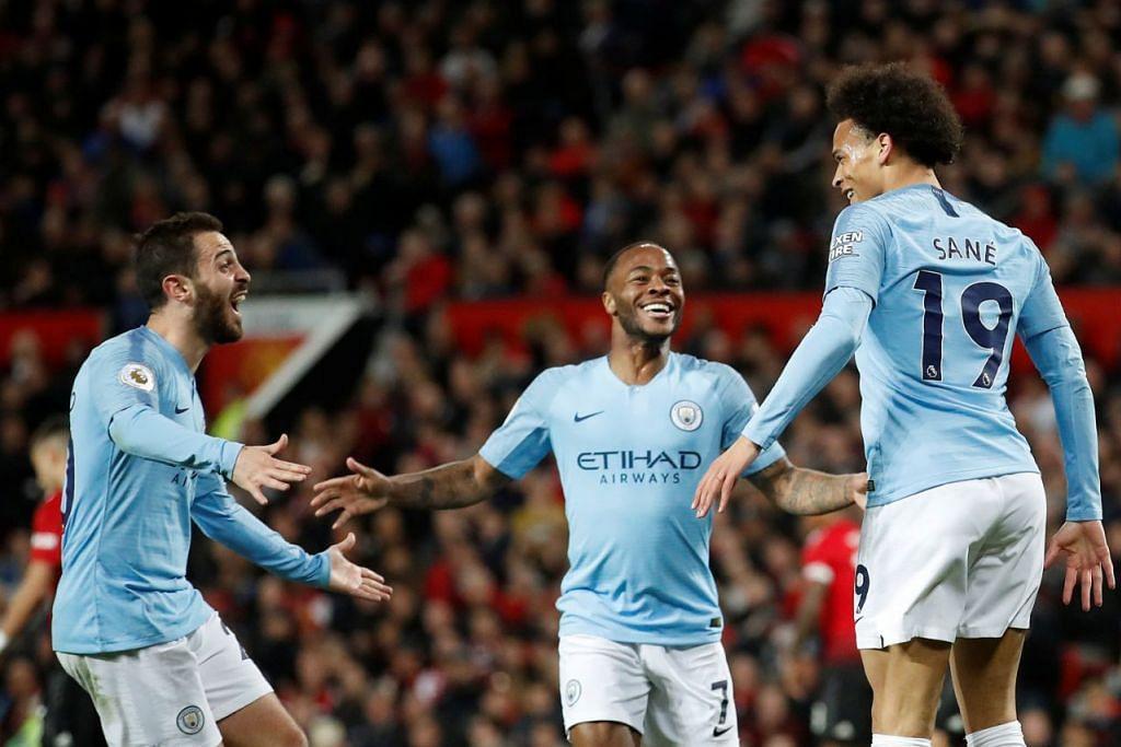 RAI GOL: Pemain Manchester City, Leroy Sane (kanan) meraikan gol kedua City dengan Bernardo Silva (kiri) dan Raheem Sterling (tengah) dalam pertandingan menentang Manchester United. - Foto REUTERS