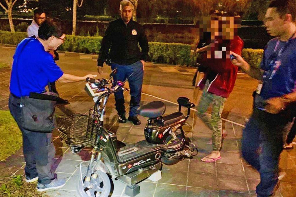 AMBIL TINDAKAN: Penunggang PMD ini ditahan dalam operasi malam di Punggol Town kerana memecut pada kelajuan 30 kilometer sejam di samping menggunakan PMD seberat 60 kilogram yang tidak mengikut ketetapan undang-undang di lintasan awam. - Foto LTA