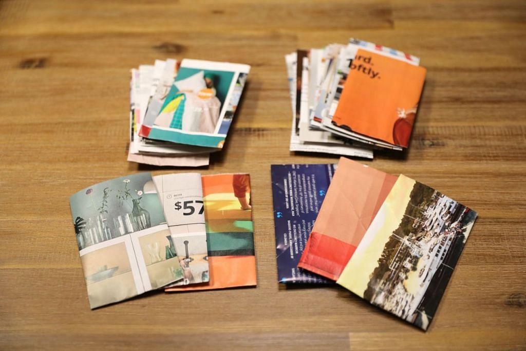 SAMPUL RAYA UNIK: (Atas) Deretan beberapa keping sampul Raya yang dibuat sendiri dari akhbar dan buku lama.