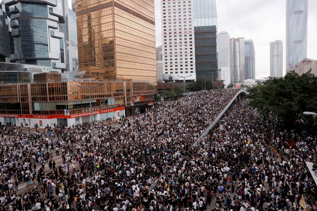 Hong Kong delays debate on extradition Bill as thousands of protesters block key roads