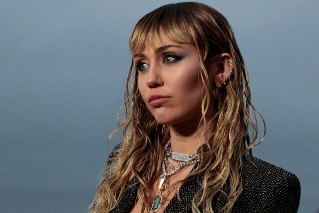 BUKAN SEORANG PEMBOHONG: Miley Cyrus (di atas) menyatakan satu aliran tweet yang marah atas hubungannya dengan Liam Hemsworth kerana dituduh menipu terhadap suaminya. PHOTO: AFP