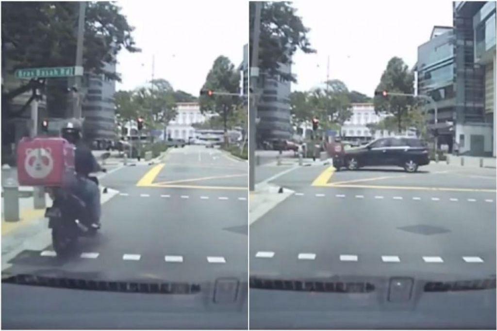LANGGAR LAMPU MERAH: Dalam video, penunggang motosikal tidak berhenti walaupun lampu trafik telah sedang merah, beberapa saat kemudian  penunggang dilanggar sebuah kereta hitam dari sebelah kanannya ketika berada di tengah-tengah persimpangan. -Foto: SCREENGRAB DARI FACEBOOK / SG ROAD VIGILANTE - SGRV