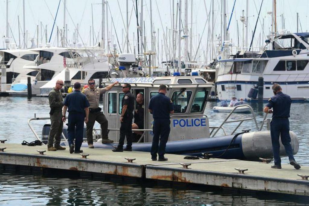 TIADA TERSELAMAT: Kesemua 34 penumpang kapal selam yang dijilat api di Pulau Santa Cruz terkorban. Operasi menyelamat sedang dijalankan. -Foto AFP.