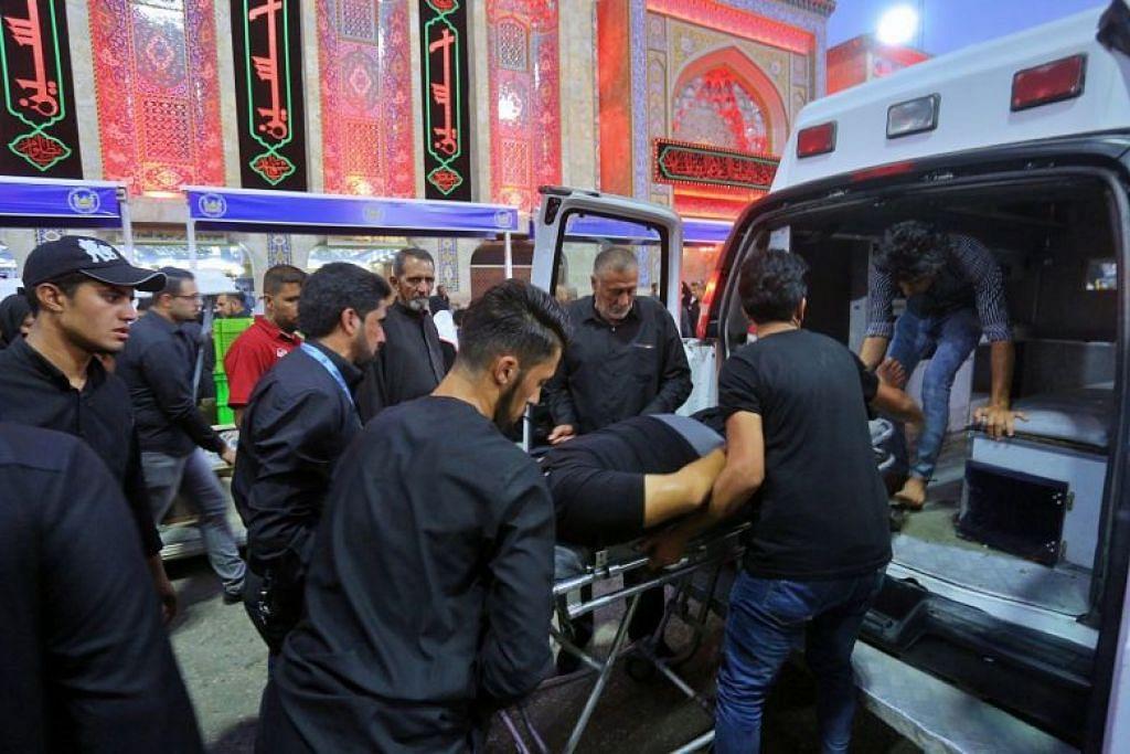 TERKORBAN: 31 penganut Syiah terkorban sementera 102 lagi cedera akibat satu rempuhan sewaktu upacara keagamaan sempena Hari Ashura pada Selasa (10 September). -Foto AP.