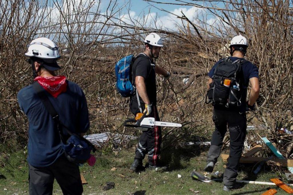 USAHA MENCARI DAN MENYELAMAT: Usaha mencari dan menyelamat mangsa Taufan Dorian masih dijalankan di Bahamas. -Foto Reuters.