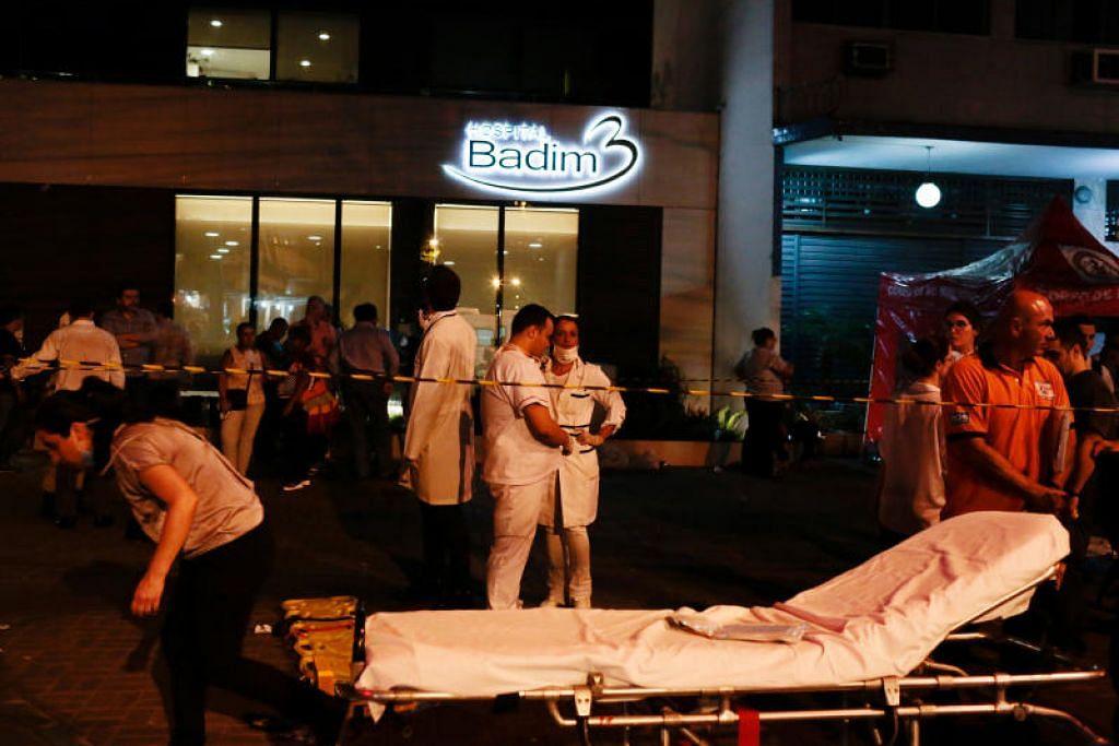 KEBAKARAN HOSPITAL: Kebakaran yang berpunca daripada letupan penjana elektrik di ruang bawah tanah Hospital Badim di Rio De Janeiro, Brazil, telah menyebabkan sebelas orang terkorban akibat terhidu asap kebakaran. -Foto Reuters.