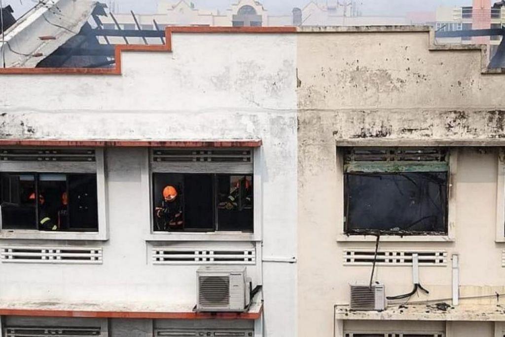 KEBAKARAN DI GEYLANG: Dua unit rumah kedai di Geylang terbakar pada hari Ahad. -Foto: SCDF/FACEBOOK