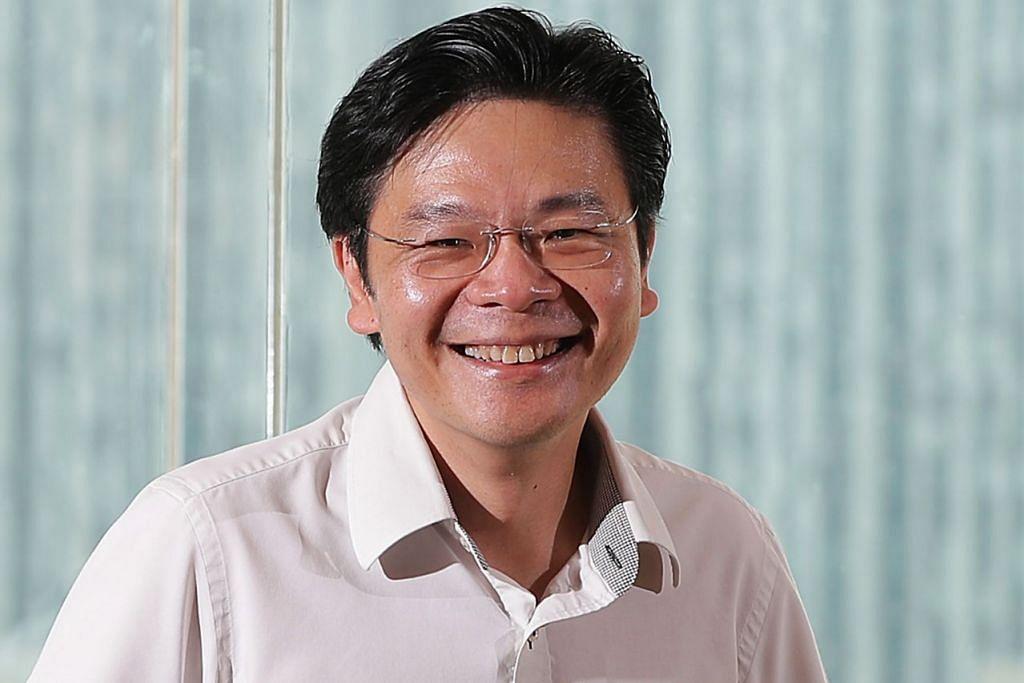 Encik Lawrence Wong (gambar atas).