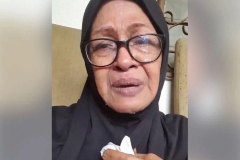 Fauziah Nawi kelihatan sebak apabila jenazah anaknya, Mohd Firdaus Mohamad Hanif, pulang ke kediamannya. - Foto FAUZIAH NAWI/INSTAGRAM