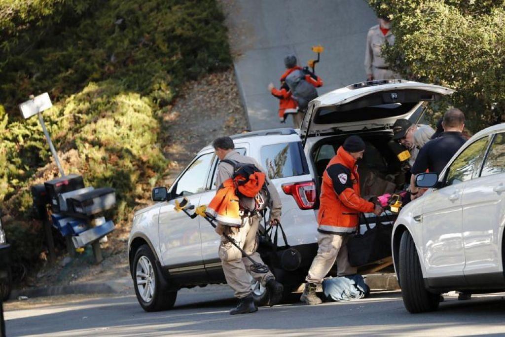 Pekerja penyelamat menuju ke tempat kejadian di sebiah rumah Airbnb, Orinda, California pada 1 November. - Foto EPA-EFE