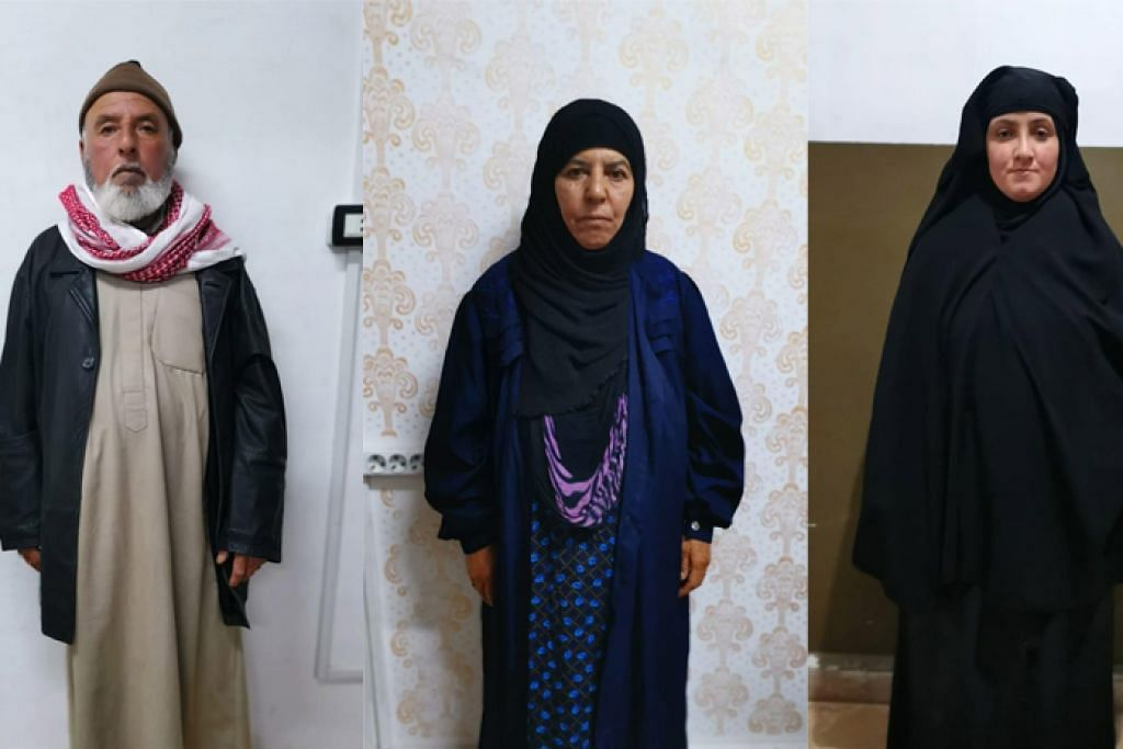 DITAHAN: (Dari kiri) Lelaki yang dipercayai suami Rasmiya Awad, kakak Baghdadi; Rasmiya Awad (tengah) dan wanita yang dipercayai anak menantu Rasmiya Awad. - Foto-foto EPA-EFE