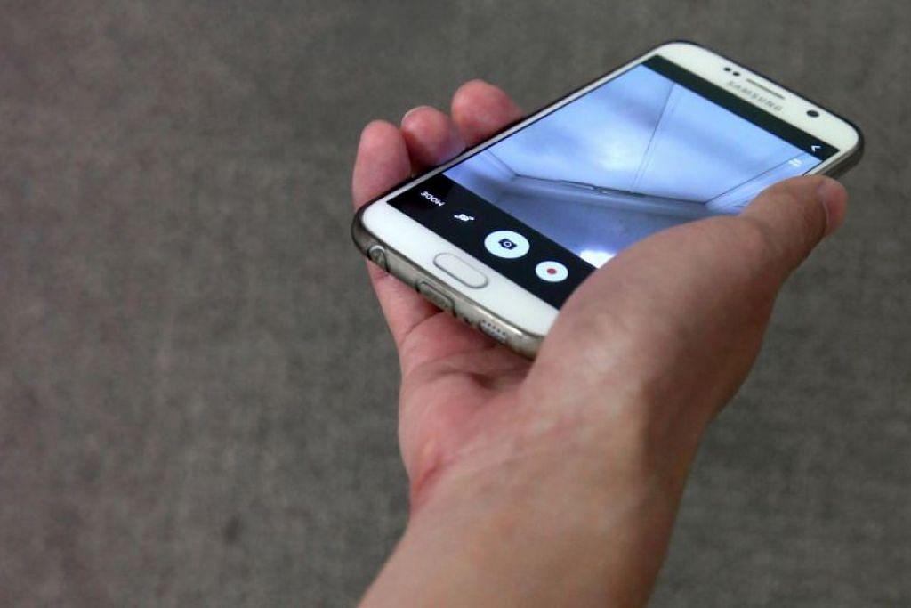 Telefon bimbit Chong didapati mengandungi beberapa video tidak senonoh melibatkan wanita yang tidak dikenali. FOTO: FAIL
